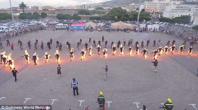 The 32 people that were set alight walked in unison across a car park to break the record