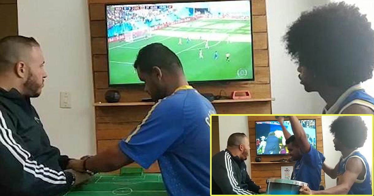 deaf blind football fan celebrates brazils victory against costa rica 1.jpg?resize=636,358 - Deaf-Blind Football Fan Celebrates Brazil's Victory Against Costa Rica As His Friend Describes Everything To Him Using A Miniature Pitch