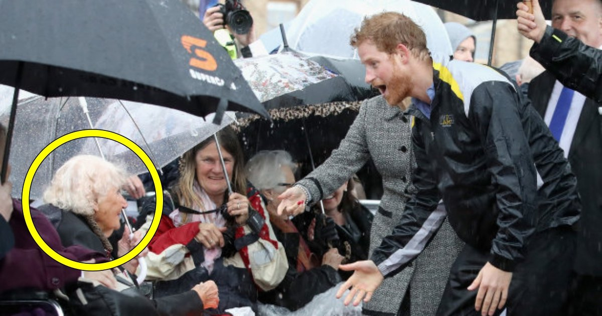 patron of the invictus games foundation prince harry hugs 97 year old picture id693240368 1.jpg?resize=636,358 - Prince Harry Recognizes 97-Year-Old Fan In The Rain And Gives Her A Hug