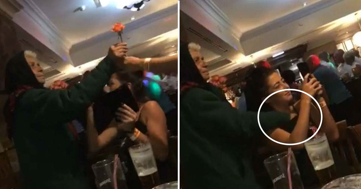 rose.jpg?resize=1200,630 - Footage Shows Flower-Seller Slip Her Hand Down Woman's Top in a Pub