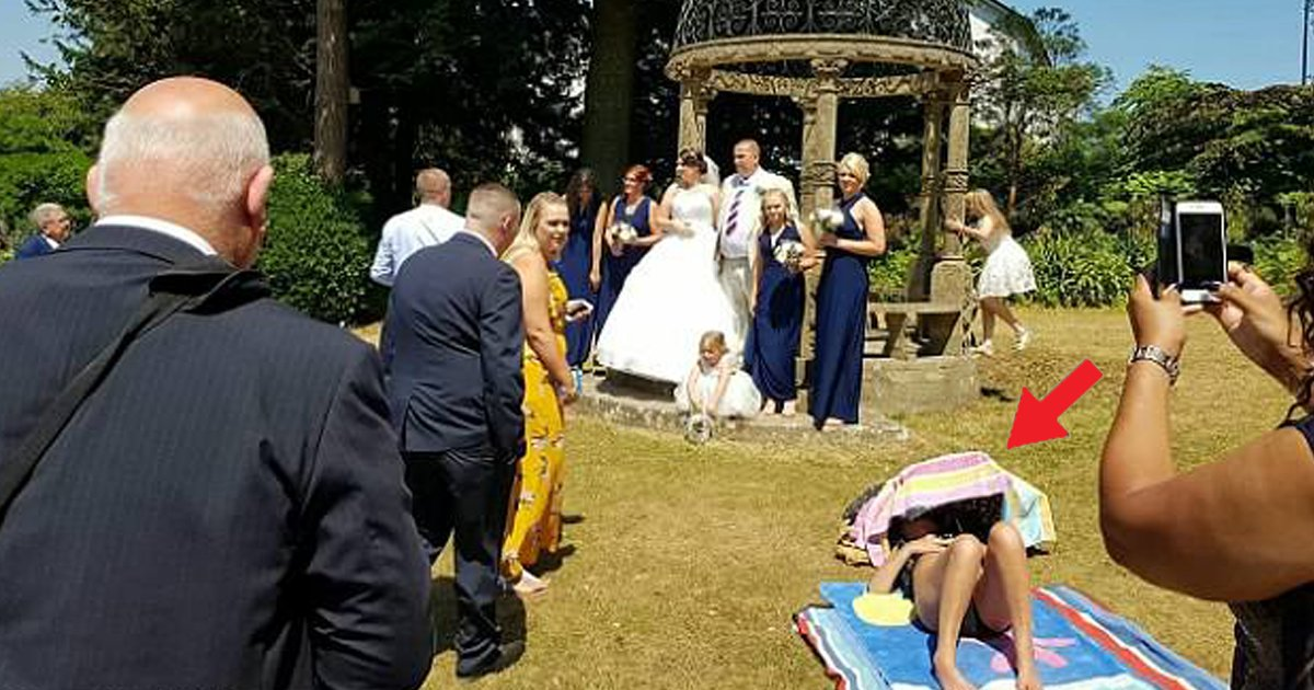 66.jpg?resize=636,358 - Woman Refuses To Move For A Couple Taking Wedding Photo Because She Is Sunbathing