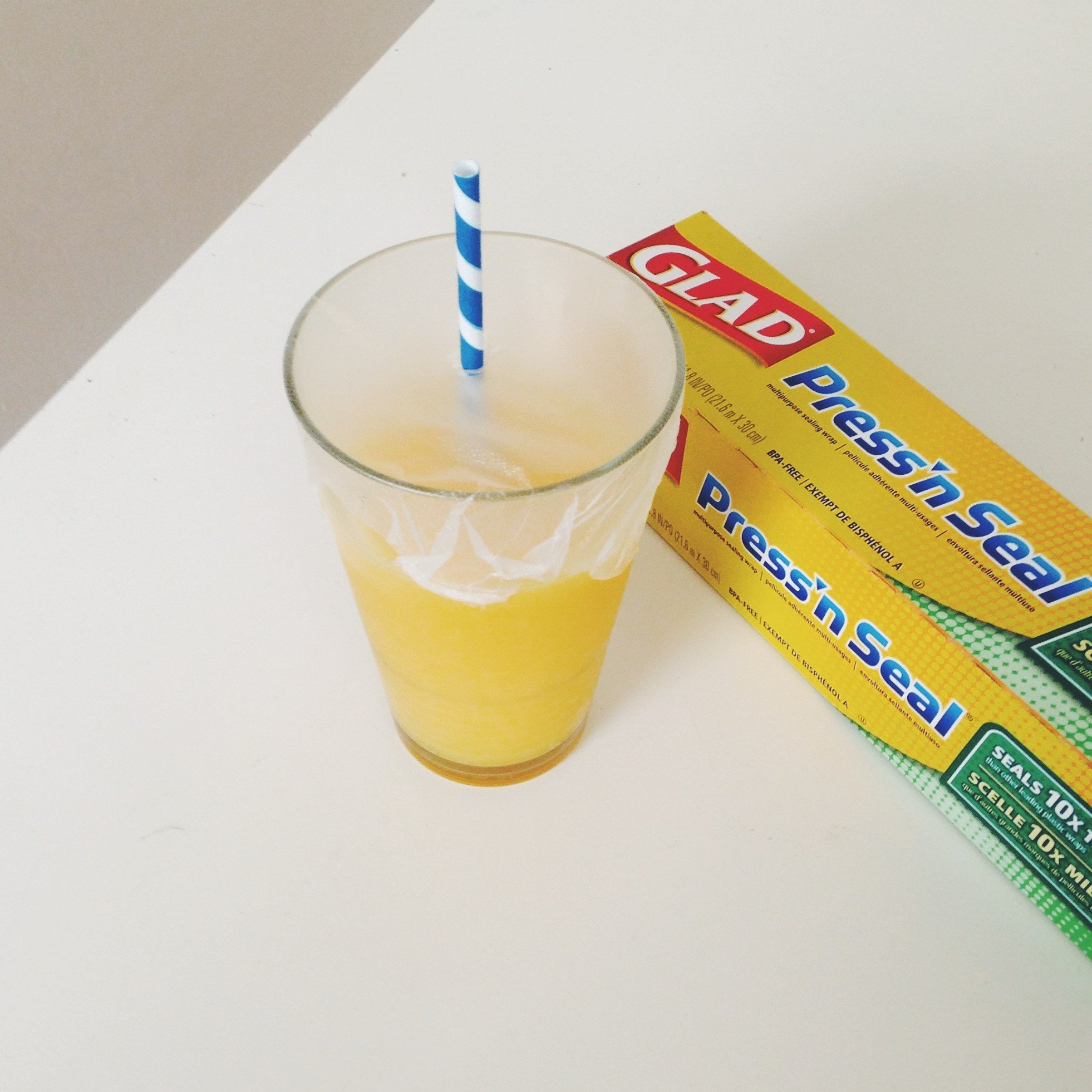A DIY To-Go Cup for smoothies using Glad Press N Seal Wrap and A Straw
