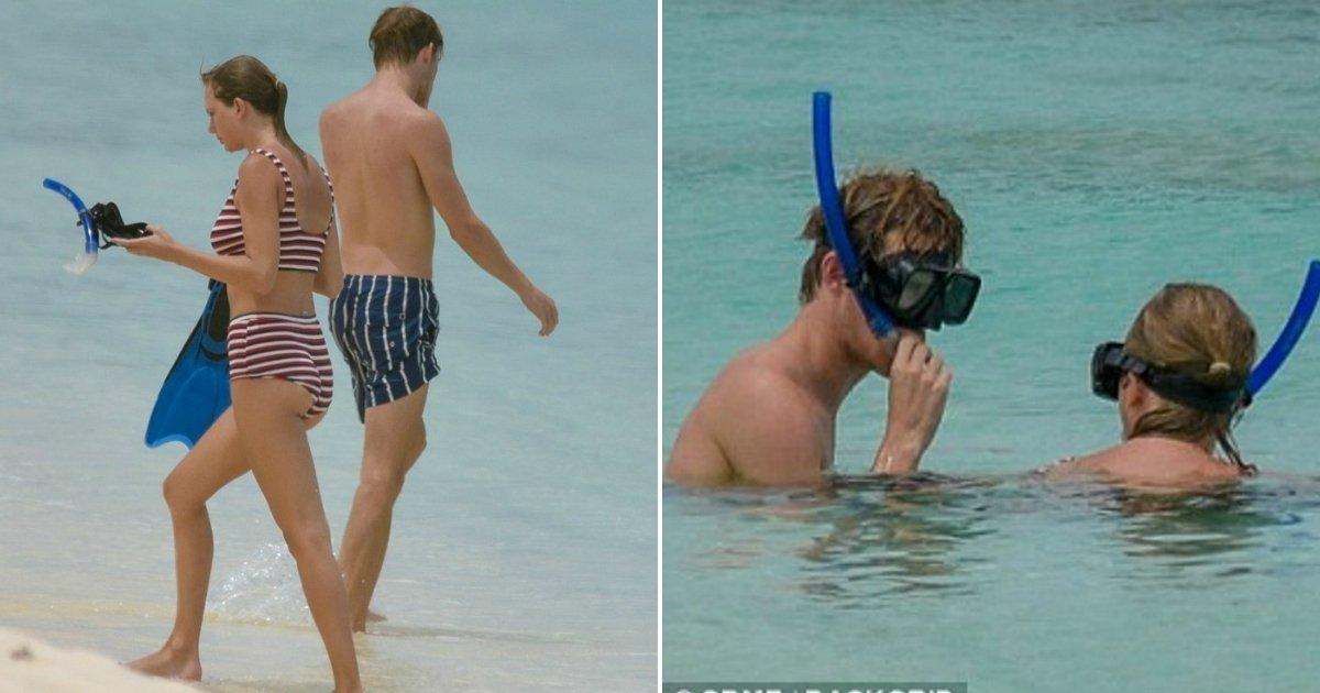 swift striped bikini.jpg?resize=648,365 - Taylor Swift Slips Into Striped Bikini As She And Boyfriend Joe Alwyn Enjoy Snorkeling In Turks And Caicos