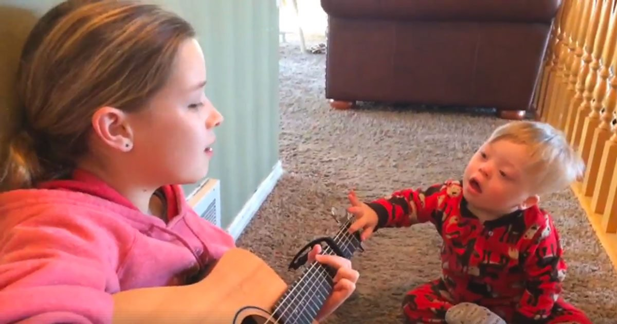 toddler down syndrome sings you are my sunshine featured.jpg?resize=1200,630 - Down Syndrome Toddler Can Barely Speak Until Sister Plays 'You Are My Sunshine'
