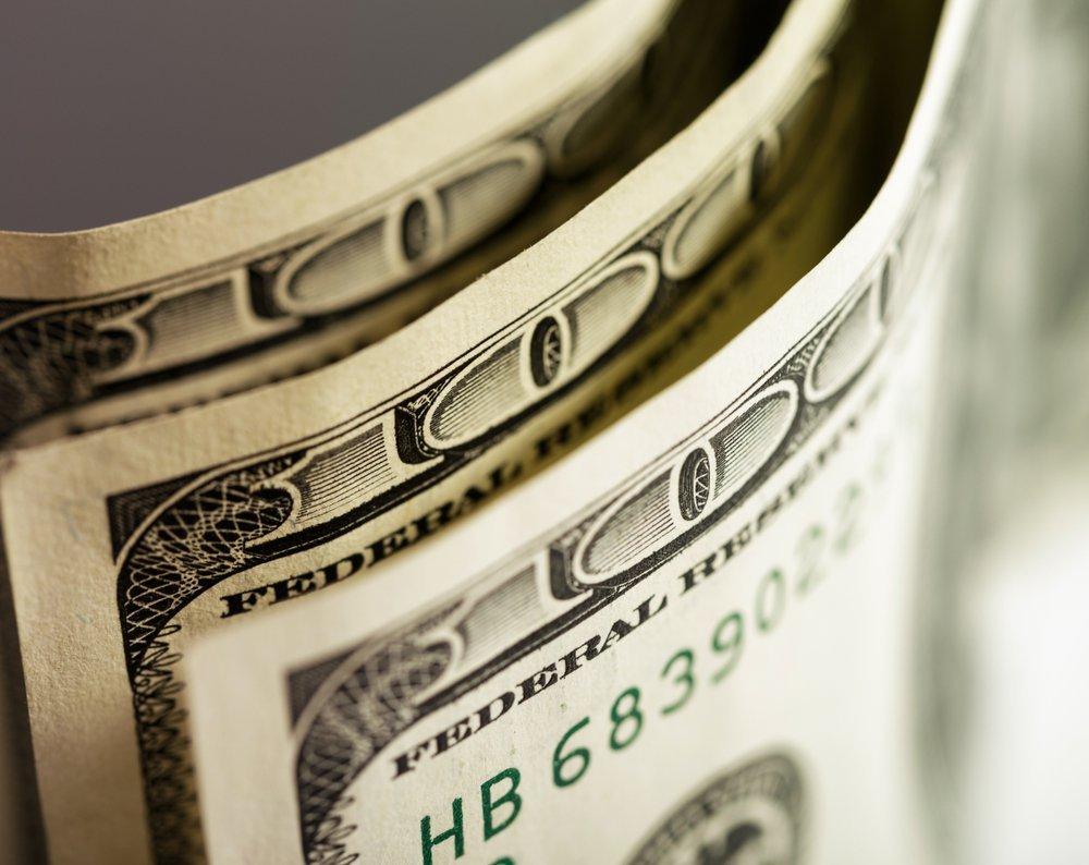 Macro shot of a 100 dollar. Dollars Closeup Concept. American Dollars Cash Money. One Hundred Dollar Banknotes. Hundred Bucks. Benjamin Franklin