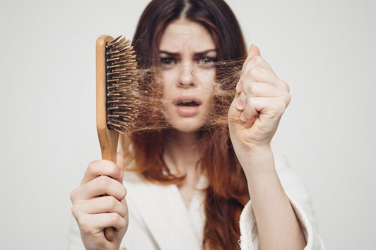 Girl-with-a-comb-and-problem-hair.jpg