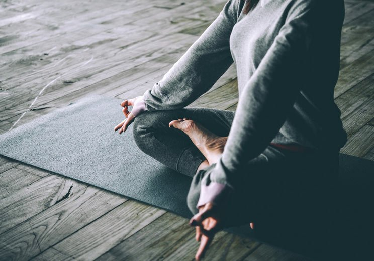 Young-Woman-Meditates-While-Practicing-Yoga.jpg