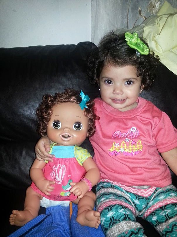 Girl With Her Look Alike Doll