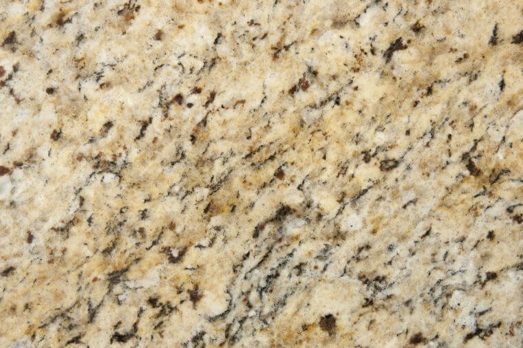 Beige and Brown Granite Surface Texture. Focus across entire surface.