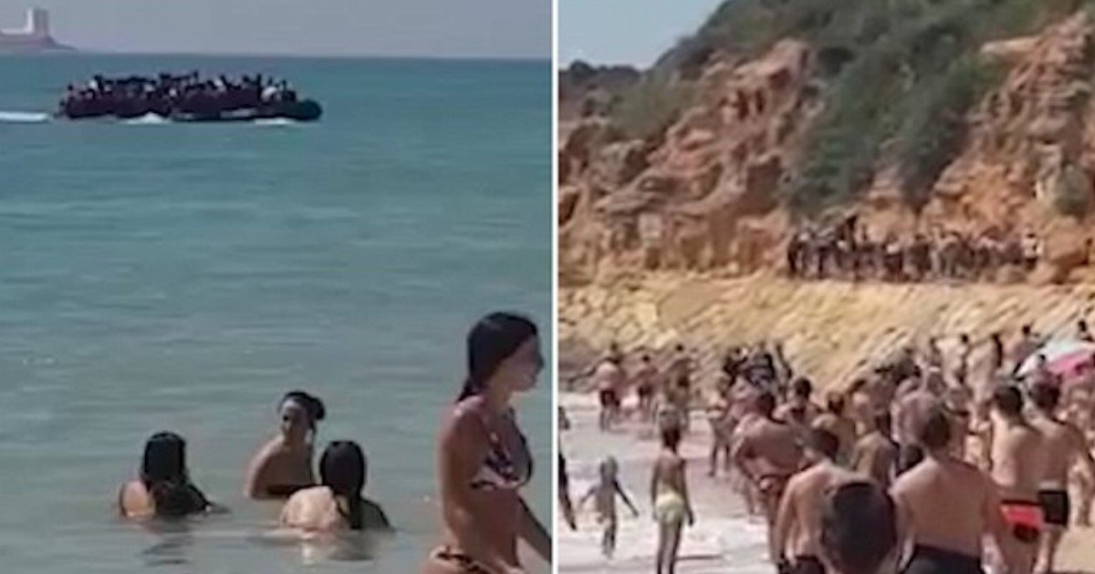 featured image copy.jpg?resize=636,358 - Tourists Watch As Packed Boat Carrying 50 Migrants From Morocco Lands On Spanish Beach