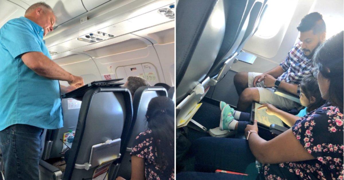 on plane.jpg?resize=412,232 - Un tout-petit pleure de façon hystérique dans l'avion jusqu'à ce qu'un passager se lève et lui passe une tablette.