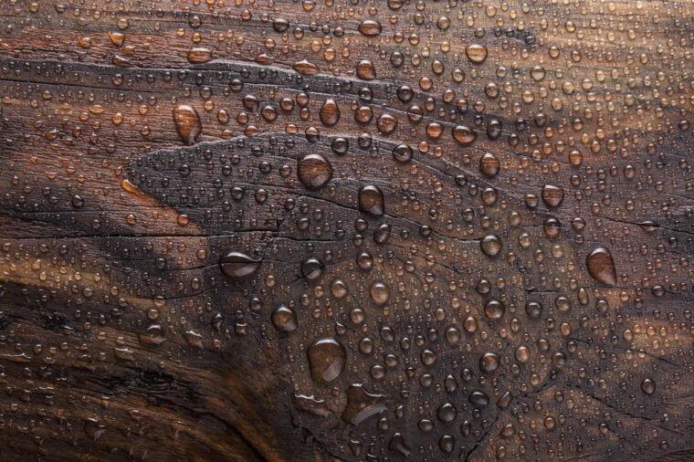 water drop in burn wooden background