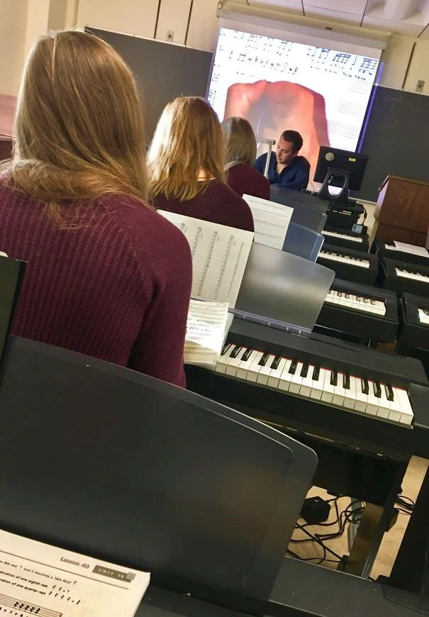 Three Girls In The Same Row, Wearing The Same Color Sweater, With The Same Color Hair