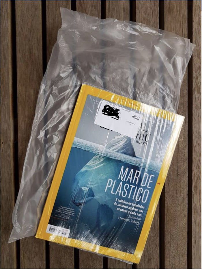 National Geographic Magazine That Warns About Danger Of Plastic Bags Comes Inside A Plastic Bag That Is Inside A Plastic Bag