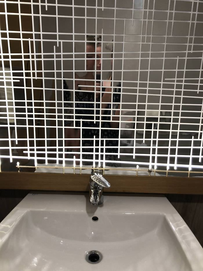 Bathroom Mirror At A Bar In Italy