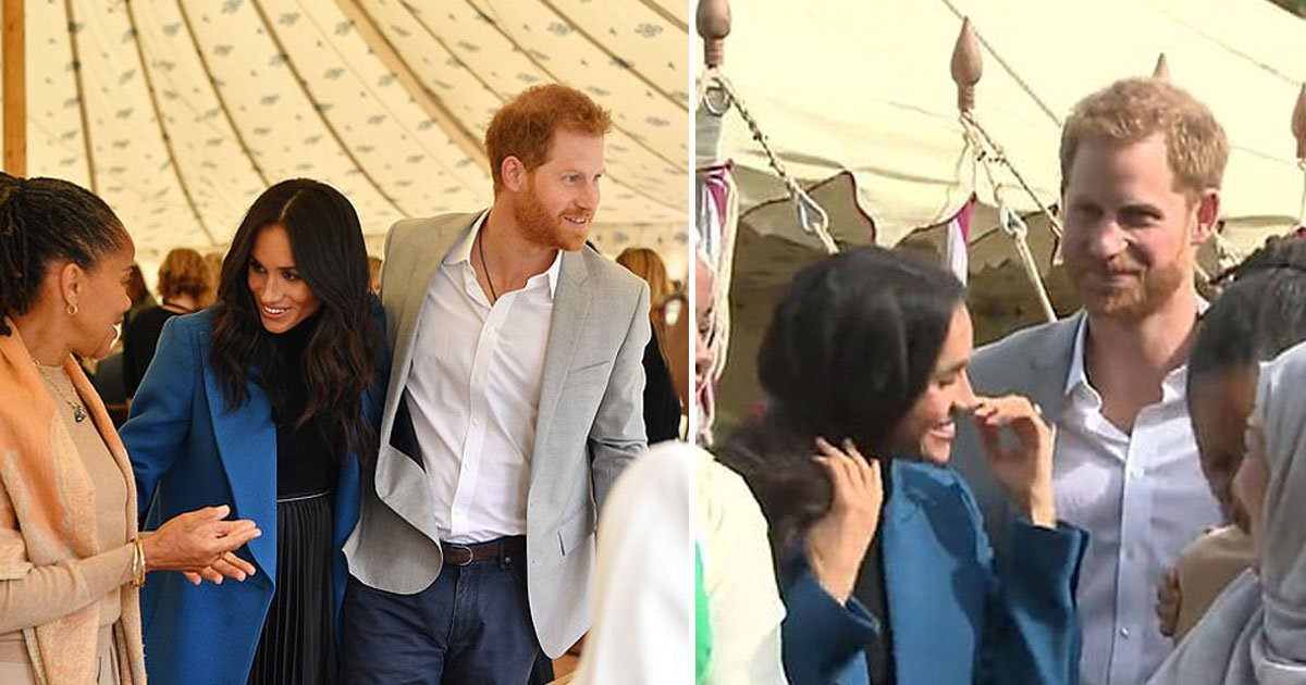 harry meghan 1.jpg?resize=412,232 - Prince Harry Smoothing Meghan Markle's Hair As The Wind Whipped It Is The Cutest Thing On The Internet Today