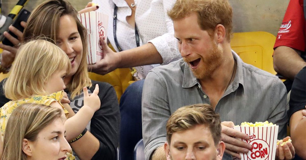 prince harry catches toddler stealing popcorn from his bucket and he responds in the sweetest way.jpg?resize=412,275 - Prince Harry Caught Toddler Stealing From His Bucket Of Popcorn