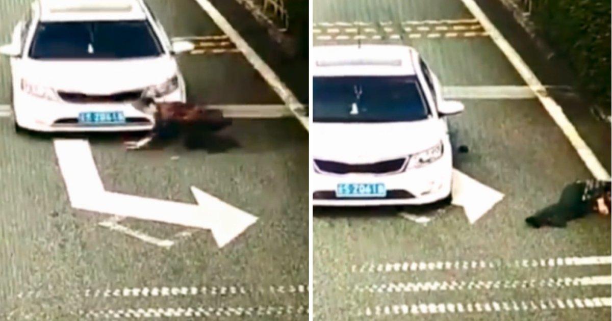 scammer.jpg?resize=412,232 - Cette femme, arnaqueuse Crash payant, se fait percuter par une voiture quand elle a mal effectué sa cascade