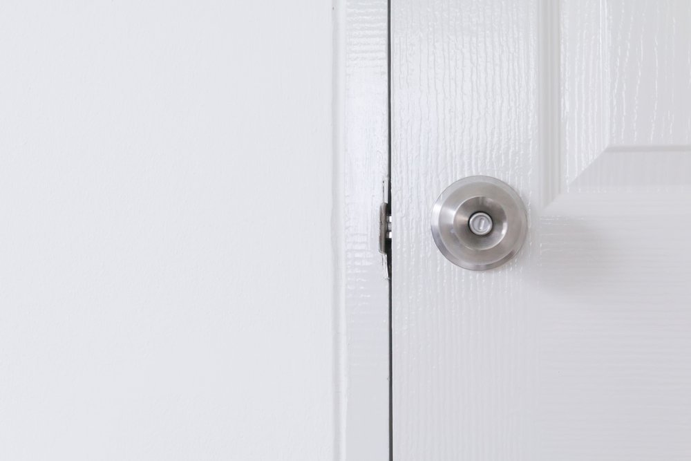 Stainless door knob,Handle on white wood door,Closeup door knob