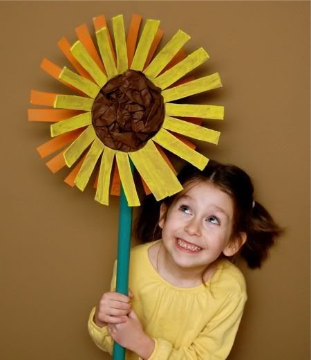 Giant sunflowers! Love! Made from empty oatmeal canisters, paint and tissue paper