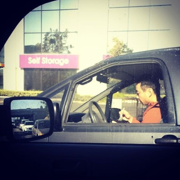 Distracted Drivers Are Everywhere, But When On The Roads In LA You Have To Step It Up. Here Is A Guy Eating A Noodle Bowl With Chopsticks While Driving No Handed And Looking Down