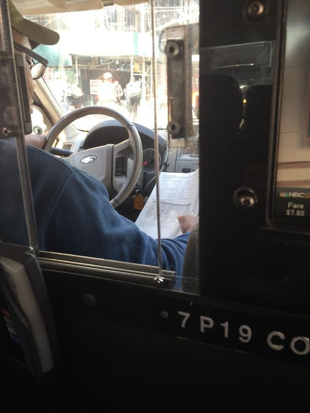 """My Cab Driver Is Reading """"Learning To Drive""""... While Driving"""