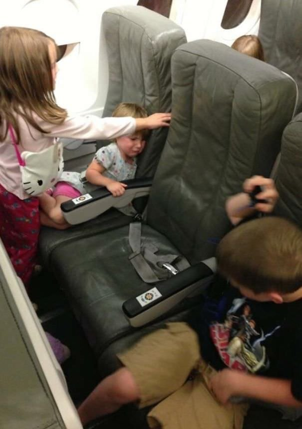 Red-Eye Flight Seattle To NY And I Don't Know These Kids. That's My Seat In The Middle
