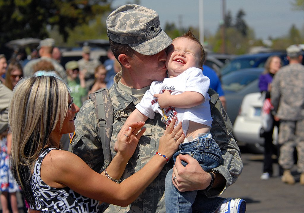 Image result for soldier reunited family