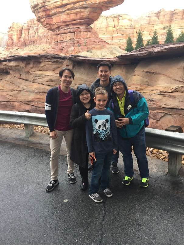 My Son Was Asked To Take A Picture Of A Nice Asian Family At Disneyland. He Did Not Understand