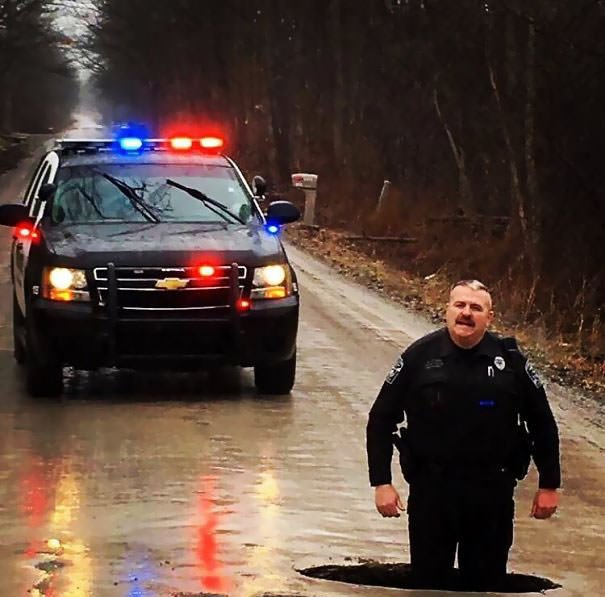So We Found A Pothole. Just For A Little Perspective, Officer Clark Is 6