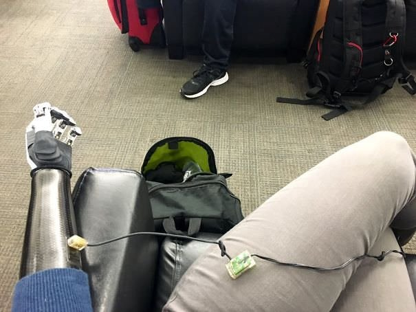 Forgot To Charge Arm Last Night. Charging At Cellphone Charge Area At Airport