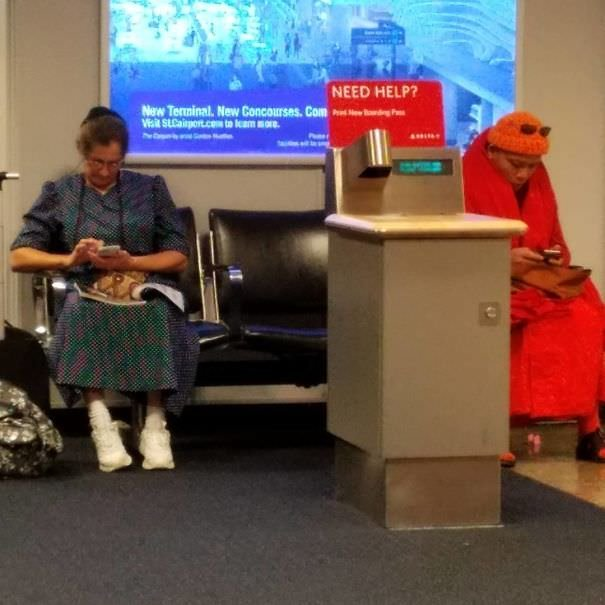A Mennonite And A Buddhist Monk... Both On Cellphones At The Airport. You Can