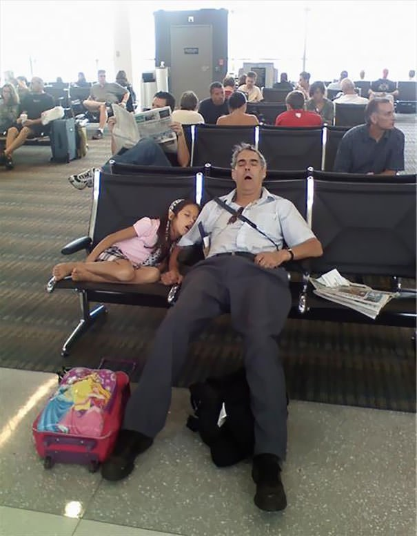 "Saw This Father & Daughter Sleeping In The Airport And All I Could Think Was, ""Genetics"""