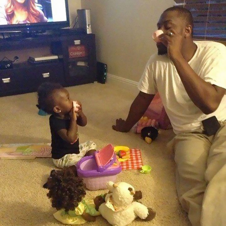 16 Super Dads Are Heroes to Their Kids - Having a daughter-daddy tea party.