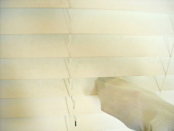 16 Cleaning Tips and Hacks - Clean dirty blinds using a sock.