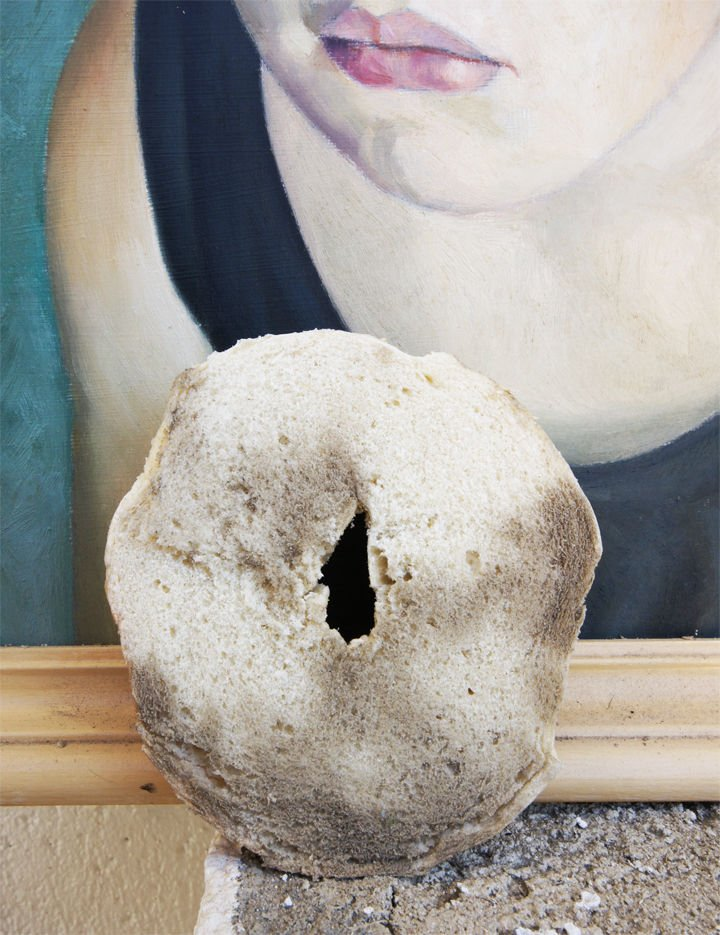 16 Cleaning Tips and Hacks - Clean vintage paintings with a bagel.