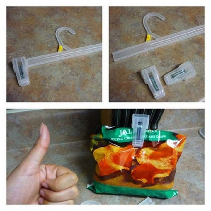 17 Kitchen Hacks - Have store hangers in your closet? Make DIY chip clips out of them.