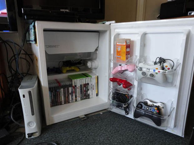 18 Upcycling Ideas - Instead of throwing out a broken refrigerator, use it to store your games and as a TV stand.