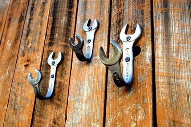 18 Upcycling Ideas - Bend old wrenches into wall hooks.