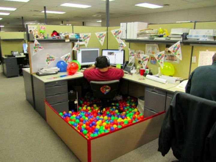 25 Office Pranks - A cubicle with a ball pit makes work fun.