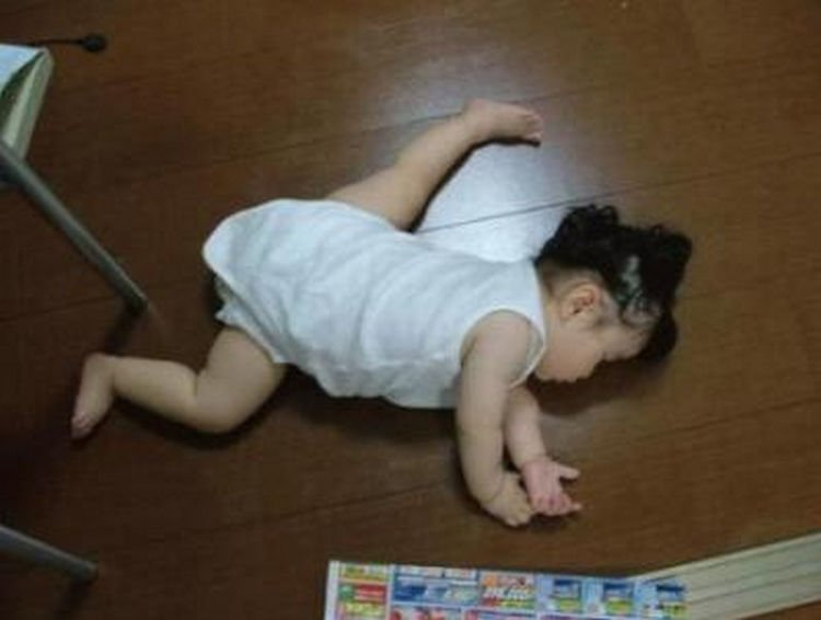 25 Kids Sleeping in the Strangest Places - Future gymnast?