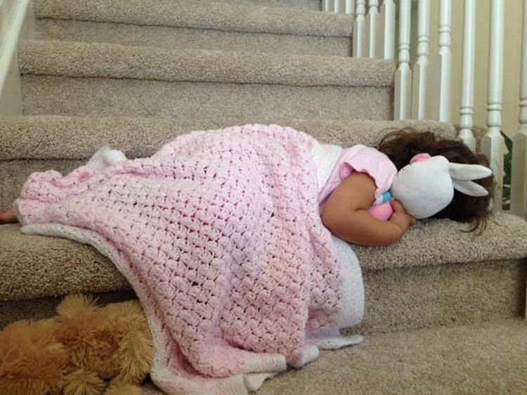 25 Kids Sleeping in the Strangest Places - She adorably couldn