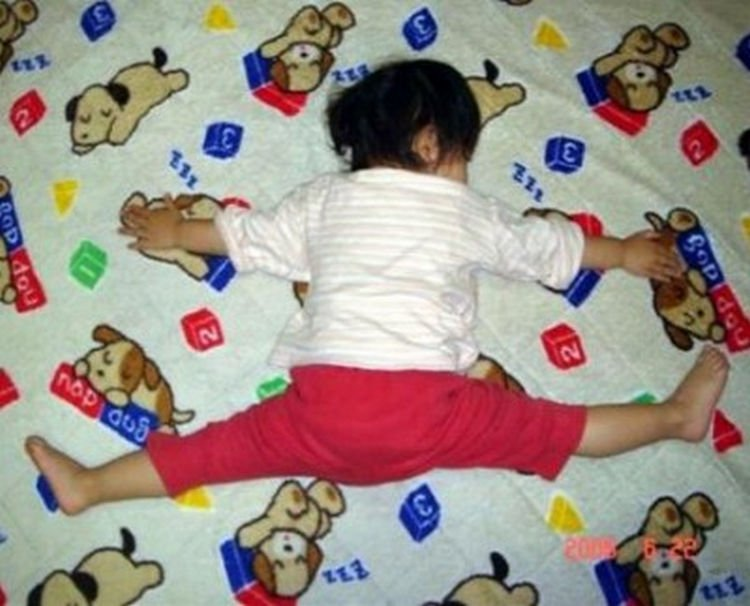 """25 Kids Sleeping in the Strangest Places - She loves her bed """"this much."""""""