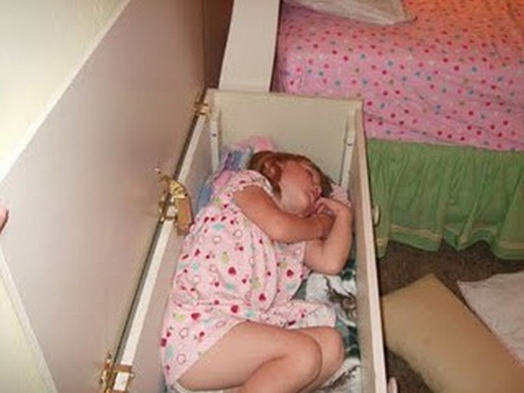 25 Kids Sleeping in the Strangest Places - A toy box makes a handy bed.