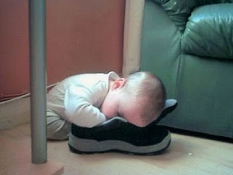 25 Kids Sleeping in the Strangest Places - He thinks this shoe is pretty comfortable!