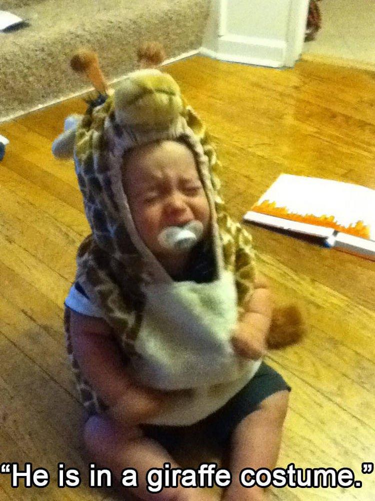 37 Photos of Kids Losing It - He is in a giraffe costume.