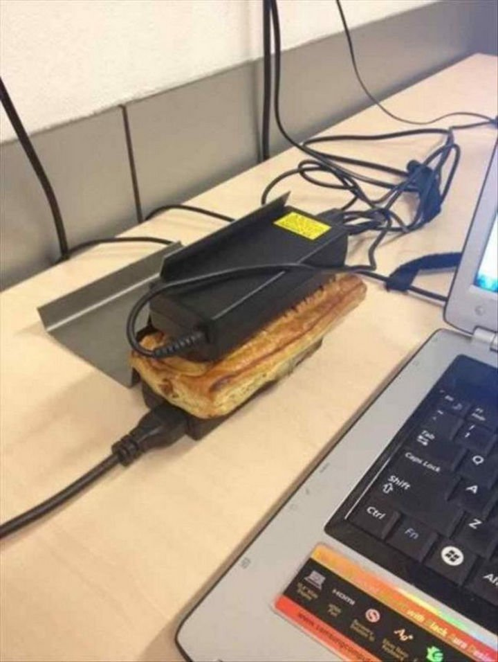 51 Crazy Life Hacks - Use a couple of laptop power cords to warm up your sandwich.