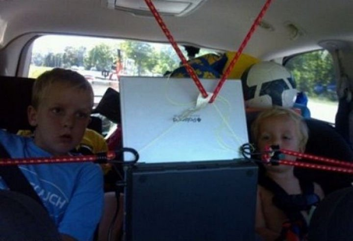 51 Crazy Life Hacks - Car trips are more fun with backseat laptop.