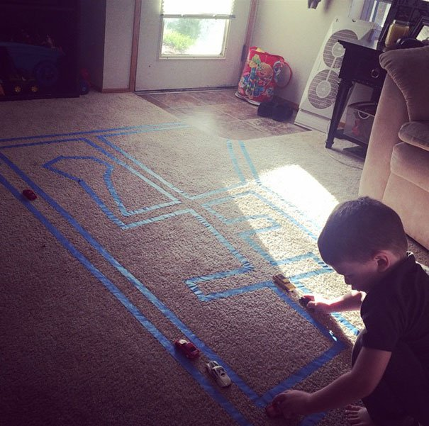 Put Masking Tape On A Carpet For Your Kid To Play With Toy Cars