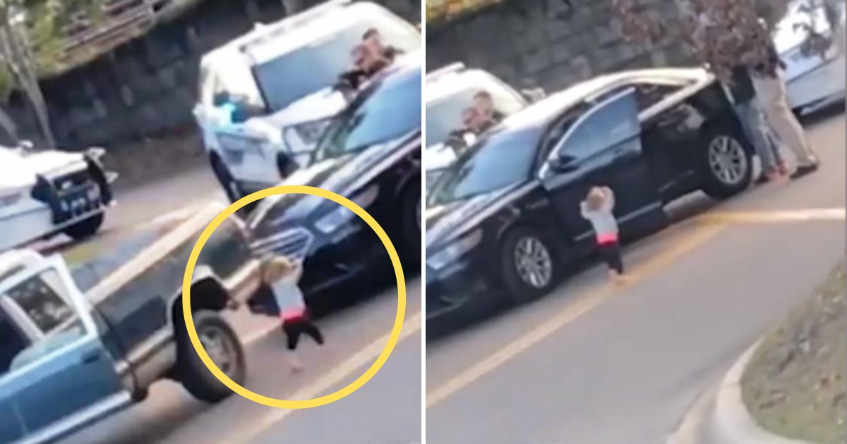 child4.png?resize=412,232 - Toddler Walked With Her Hands In the Air Towards Armed Police Officers After Her Parents Were Detained